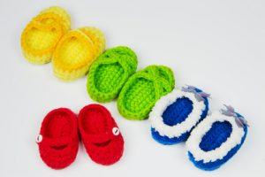 Multi color Shoes doll made of yarn.