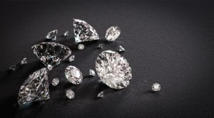 Beautiful shiny diamonds on black background