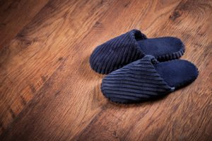 Pair of slippers on wooden floor