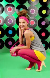 studio shot of cheerful teenage girl over colorful background